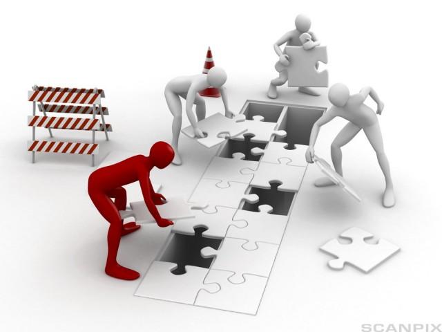 Men putting puzzle pieces together